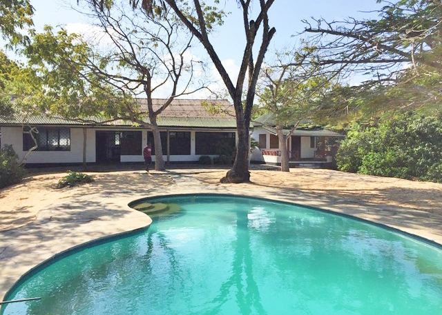 Stunning Beachfront Property with House & Cottage South Turtle Bay Beach for Sale
