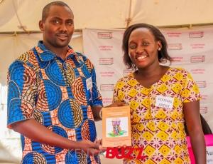 Kariuki Wa Nyamu and Nambozo displaying a book they worked on