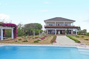 Hot Coast Property: Mwezi House