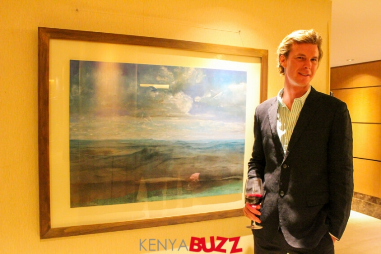David Roberts standing beside one of his painting